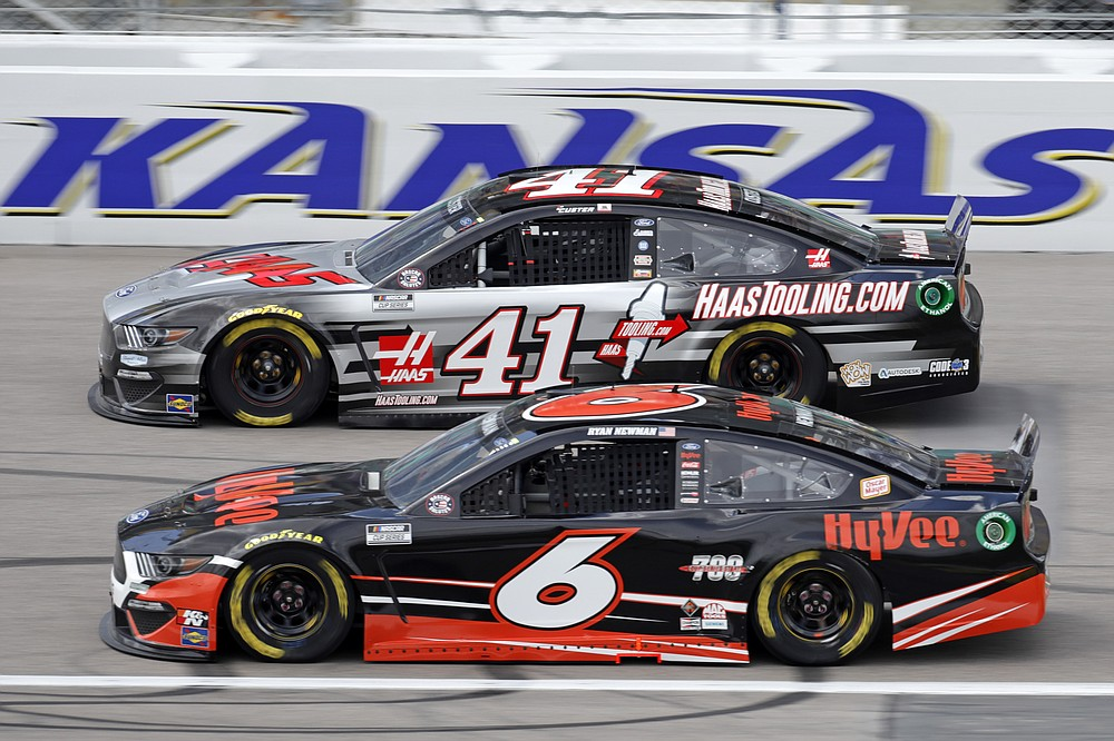 Cole Custer (41) and Ryan Newman (6) head toward turn one during a NASCAR Cup Series auto race at Kansas Speedway in Kansas City, Kan., Sunday, May 2, 2021. (AP Photo/Colin E. Braley)