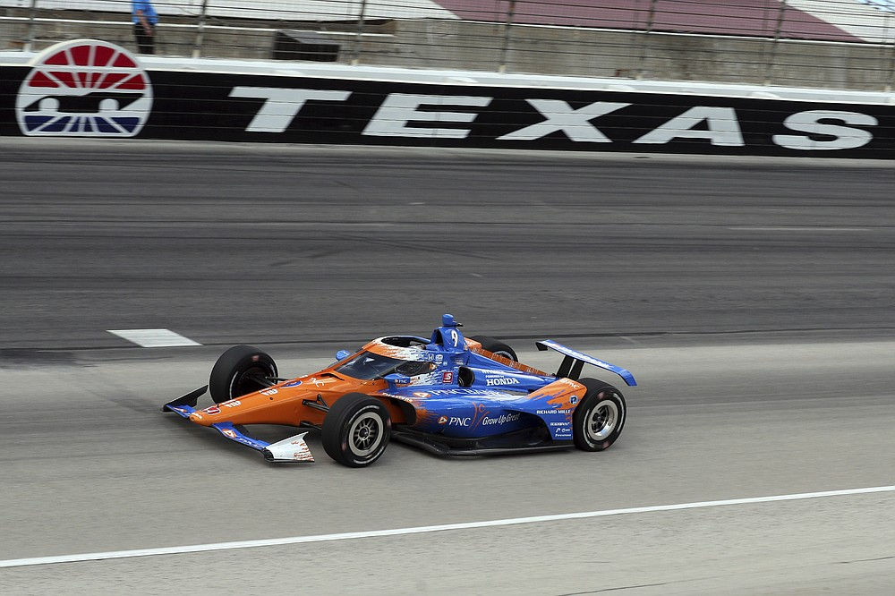 Scott Dixon comes out of turn four during an IndyCar Series auto race at Texas Motor Speedway on Sunday, May 2, 2021, in Fort Worth, Texas. (AP Photo/Richard W. Rodriguez)