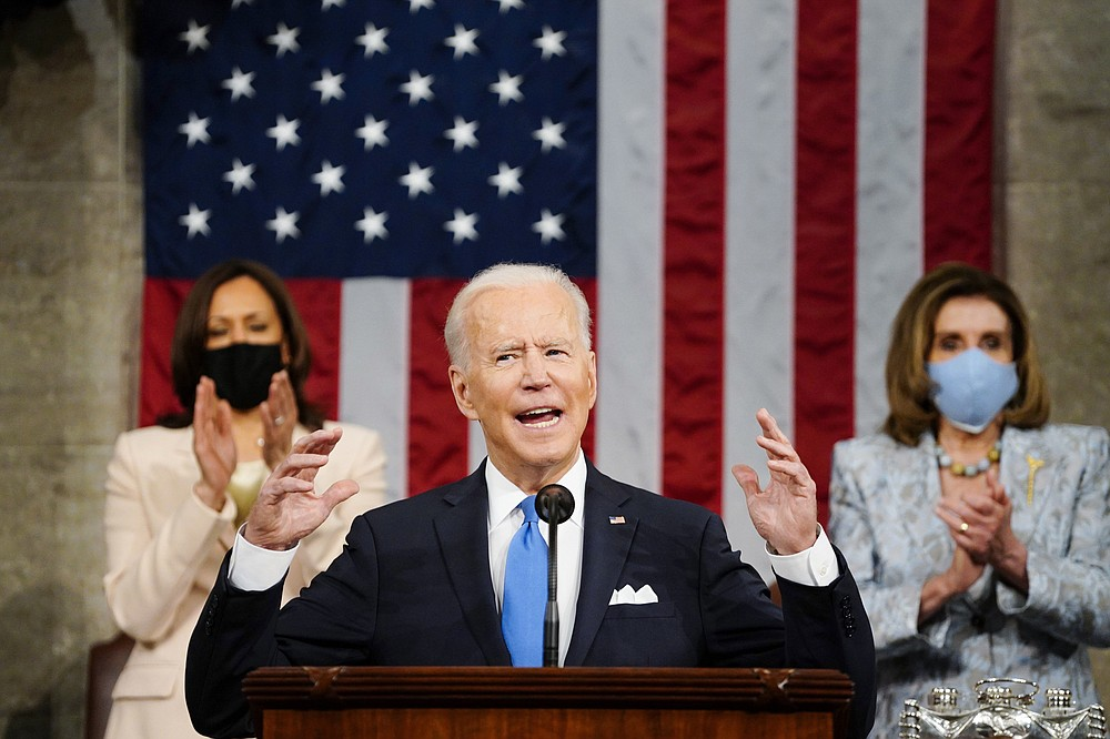 """FILE - In this Wednesday, April 28, 2021, file photo, U.S. President Joe Biden addresses a joint session of Congress in the House Chamber at the U.S. Capitol as Vice President Kamala Harris, left, and House Speaker Nancy Pelosi of Calif., applaud, in Washington. North Korea on Sunday, May 2, warned the United States will face """"a very grave situation"""" because Biden """"made a big blunder"""" in his recent speech by calling the North a security threat and revealing his intent to maintain a hostile policy toward it. (Melina Mara/Pool Photo via AP, File)"""