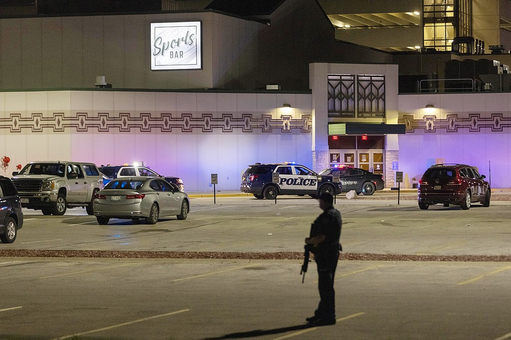 Police stand guard in the parking area outside the Oneida Casino in the early morning hours of Sunday, May 2nd, 2021, near Green Bay, Wisconsin. Authorities in Wisconsin say a gunman killed two people at a Green Bay casino restaurant and seriously wounded a third before he was shot and killed by police Saturday. (AP Photo/Mike Roemer)