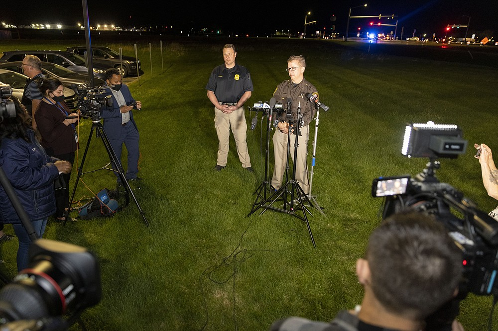 Lt. Kevin Pawlak of the Brown County Sheriff's Office talks to the media about a shooting incident with multiple fatalities at the Oneida Casino near Green Bay, Wis.,on Saturday May 1, 2021. Authorities in Wisconsin say a gunman killed two people at the casino restaurant and seriously wounded a third before he was shot and killed by police Saturday. (AP Photo/Mike Roemer)