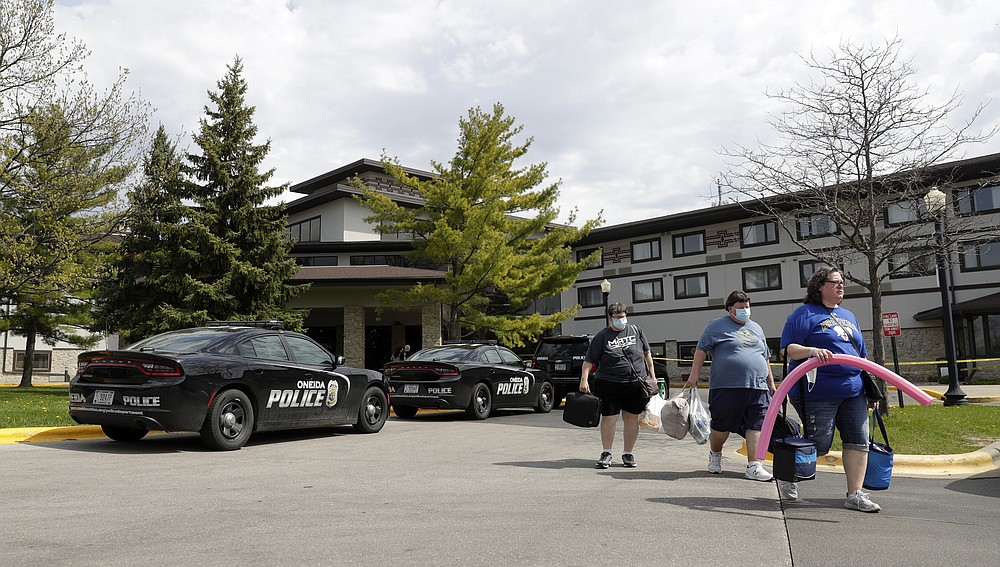 Guests leave the Oneida Casino/Radisson Hotel & Conference Center on Sunday, May 2, 2021 after a shooting took place on Saturday at the Duck Creek Restaurant in Ashwaubenon, Wis. (Sarah Kloepping/The Post-Crescent via AP)