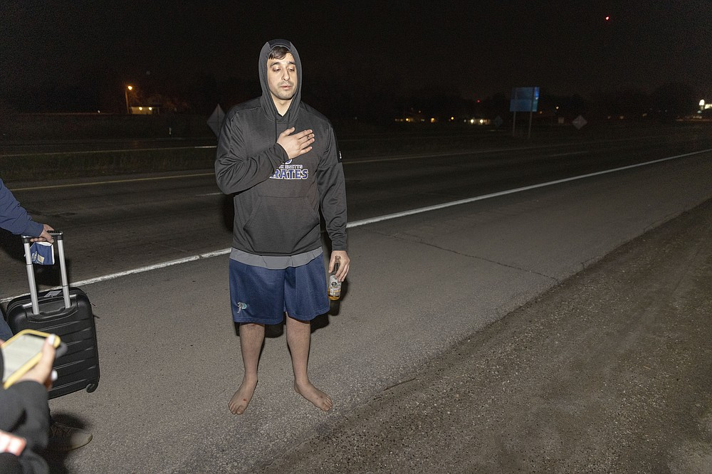 Jawad Yatim recounts seeing two people get shot at the Oneida Casino in the early morning hours of Sunday, May 2, 2021, near Green Bay, Wisconsin. Authorities in Wisconsin say a gunman killed two people at a Green Bay casino restaurant and seriously wounded a third before he was shot and killed by police Saturday. (AP Photo/Mike Roemer)