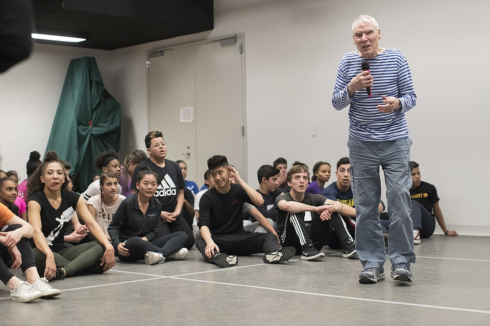FILE - Dancer-choreographer Jacques d'Amboise speaks to current and former students during the National Dance Institute alumni homecoming celebration at NDI headquarters in New York on March 3, 2018. D'Amboise, who grew up on the streets of upper Manhattan to become one of the world's premier classical dancers at New York City Ballet and spent the last four and a half decades providing free dance classes to city youth at his National Dance Institute, died Sunday, May 2, 2021. He was 86. His death was confirmed by Ellen Weinstein, director of the institute. (AP Photo/Mary Altaffer, File)