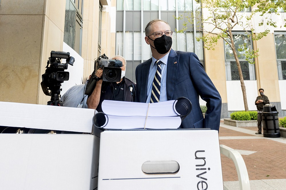 Epic Games CEO Tim Sweeney enters the Ronald V. Dellums building in Oakland, Calif., to attend his company's federal court case against Apple on Monday, May 3, 2021. Epic, maker of the video game Fortnite, charges that Apple has transformed its App Store into an illegal monopoly. (AP Photo/Noah Berger)