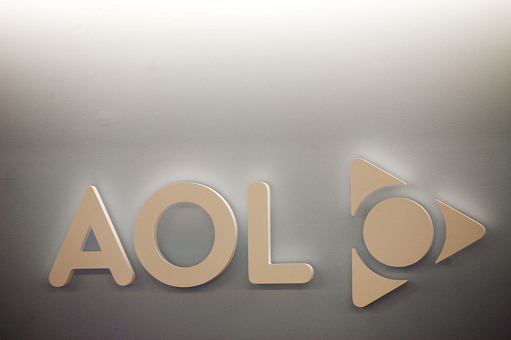 FILE - The AOL logo is shown on a wall of the company's New York office, in this Monday, May 12, 2008, file photo. Verizon is selling the segment of its business that includes Yahoo and AOL to private equity firm Apollo Global Management in a $5 billion deal. Verizon said Monday, May 3, 2021, that it will keep a 10% stake in the new company, which will be called Yahoo. (AP Photo/Mark Lennihan, File)