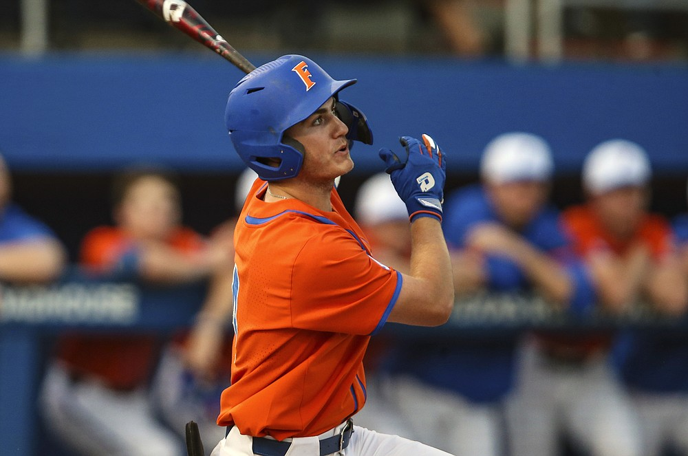 FILE - Florida outfielder Jud Fabian bats during an NCAA college baseball game against Florida A&M in Gainesville, Fla., in this Wednesday, March 4, 2020, file photo. Fabian is tied for second in the nation with 16 home runs. (AP Photo/Gary McCullough, File)