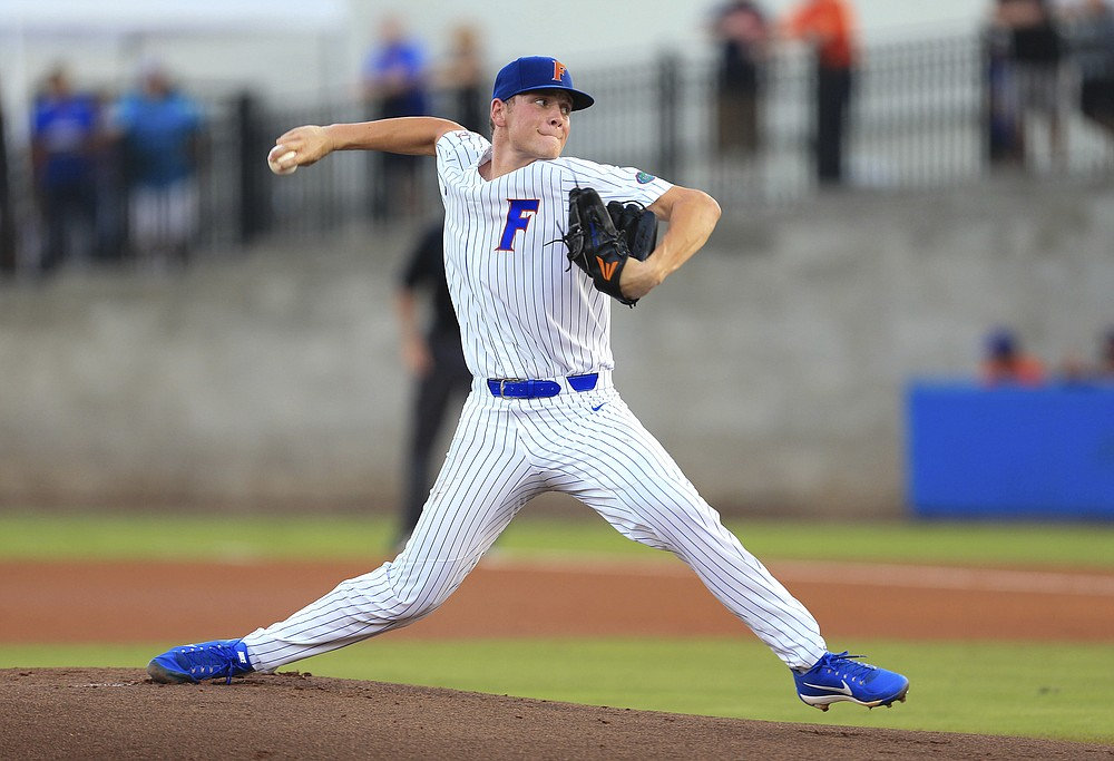 FILE - Florida pitcher Jack Leftwich throws against Auburn during the first inning of an NCAA Super Regional college baseball game  in Gainesville, Fla., in this Monday, June 11, 2018, file photo. Leftwich has moved to the bullpen after starting the season as the team's No. 2 starter. He earned two saves in the series against Vanderbilt. (AP Photo/Matt Stamey, File)
