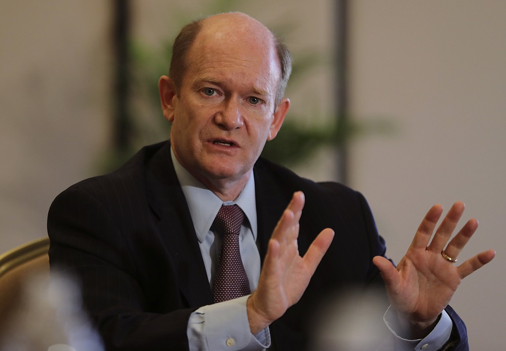 Senator Chris Coons of Delaware talks to the journalists during a press briefing in Abu Dhabi, United Arab Emirates, Monday, May 3, 2021. Top Biden administration officials and U.S. senators crisscrossed the Middle East on Monday, seeking to assuage growing unease among Gulf Arab partners over America's rapprochement with Iran and other policy shifts in the region. (AP Photo/Kamran Jebreili)