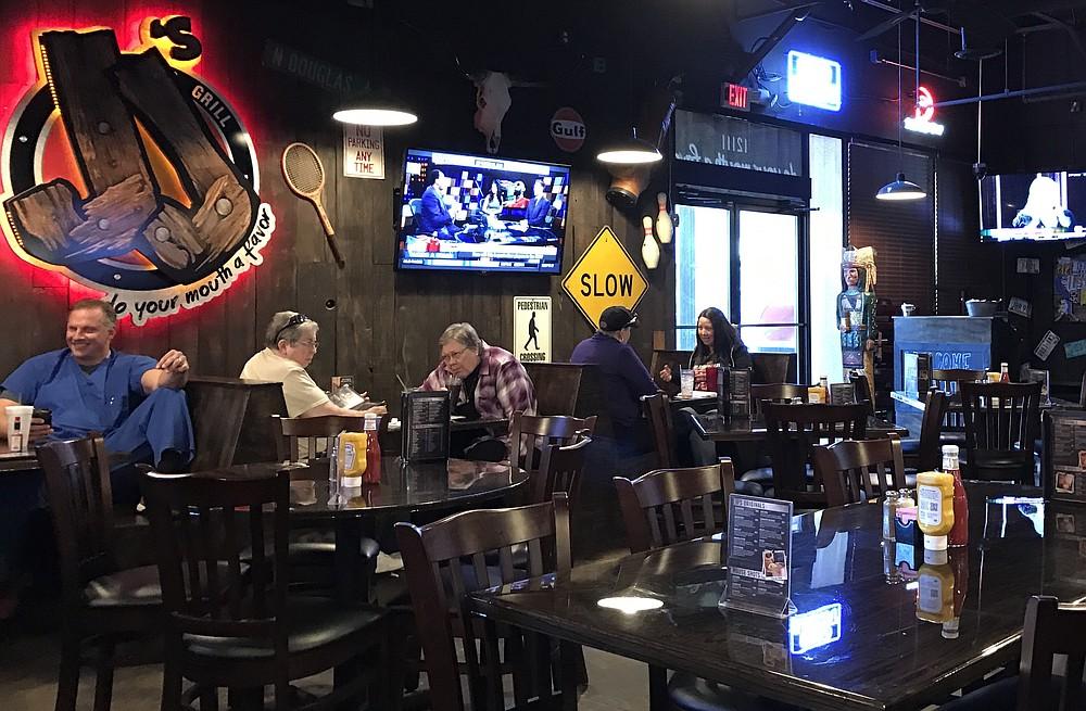 JJ's Grill on West Markham Street at Bowman Road reopens Monday. (Democrat-Gazette file photo)