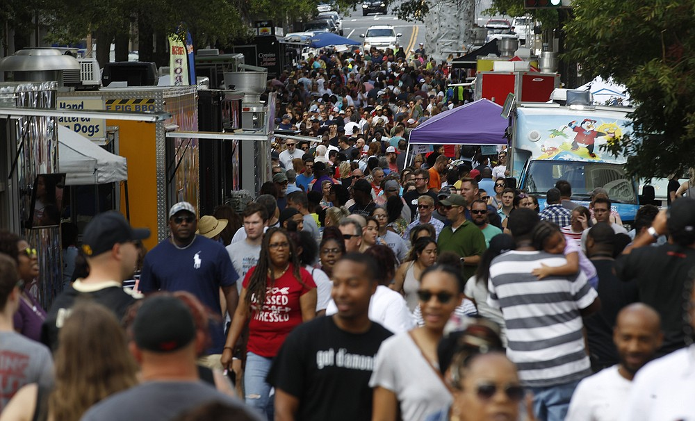 Crowds thronged downtown Little Rock for the 2019 Main Street Food Truck Festival. After being canceled for 2020 because of the pandemic, the festival returns to Main Street Oct. 2. (Democrat-Gazette file photo/Thomas Metthe)