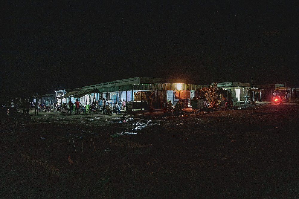 The main market in front of the clinic run by MSF (Doctors Without Borders), where surgeon and doctor-turned-refugee, Dr. Tewodros Tefera, goes to help staff, in Hamdayet, eastern Sudan, near the border with Ethiopia, on March 22, 2021. (AP Photo/Nariman El-Mofty)