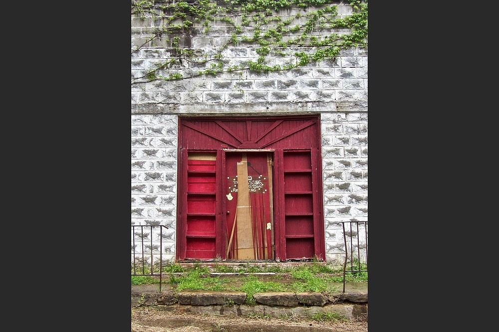 The door of a former funeral home stands ajar in East Calico Historic District. (Special to the Democrat-Gazette/Marcia Schnedler)