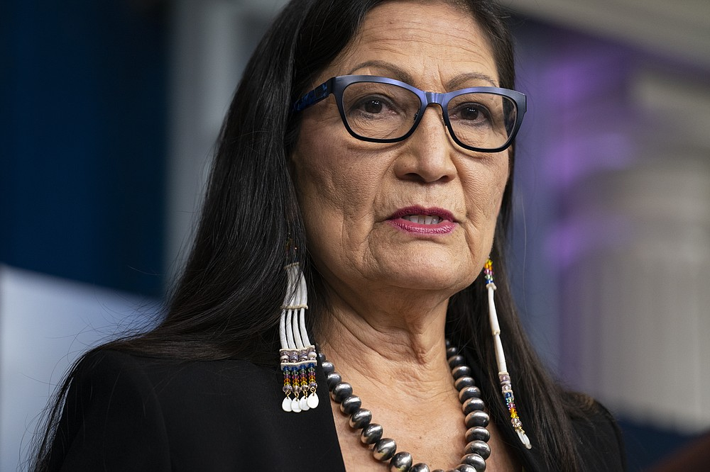 FILE - In this April 23, 2021, file photo, Interior Secretary Deb Haaland speaks during a press briefing at the White House in Washington. Haaland on Tuesday, April 27, 2021, announced steps intended to speed up the transfer of private lands into federal trust for the benefit of Native American tribes. (AP Photo/Evan Vucci, File)