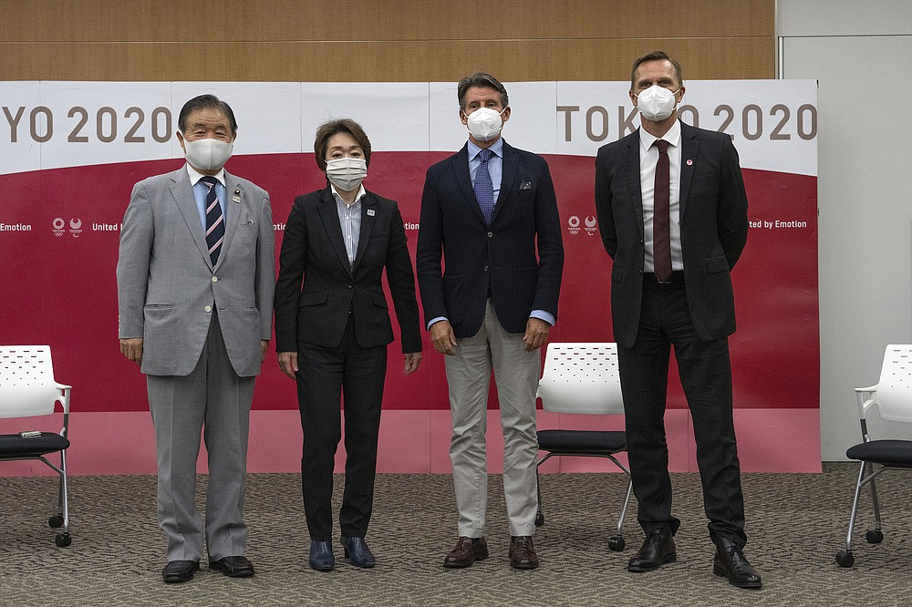 Toshiaki Endo, left, vice president of the Tokyo 2020 Organizing Committee, Seiko Hashimoto, second left, president of the Tokyo 2020 Organizing Committee, Sebastian Coe, third from left, president of World Athletics and John Ridgeon, World Athletics CEO, pose for a photograph ahead of a meeting Friday, May 7, 2021 in Tokyo, Japan. (Carl Court/Pool Photo via AP)