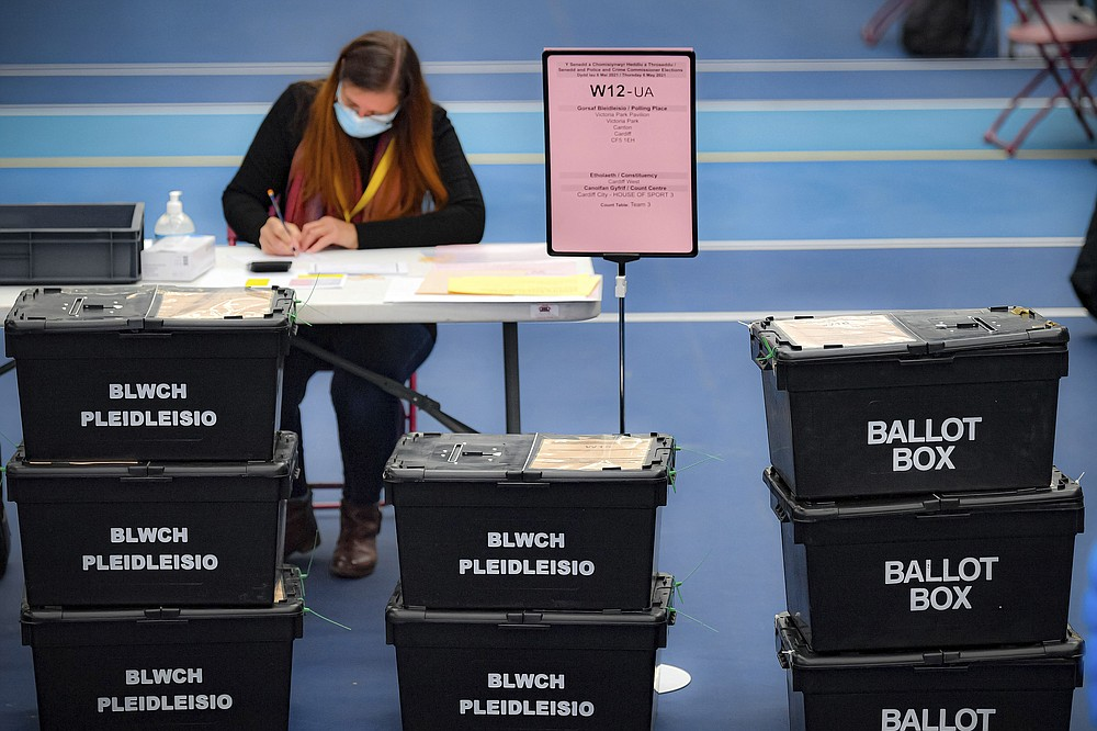 Ballot boxes arrive for counting votes for the Welsh Parliamentary Elections at the Cardiff House of Sport, Cardiff, Wales, Friday May 7, 2021.  The counting is taking place Friday for an array of elections across Britain on Thursday, some of which had been postponed a year because of the coronavirus pandemic. (Ben Birchall/PA via AP)
