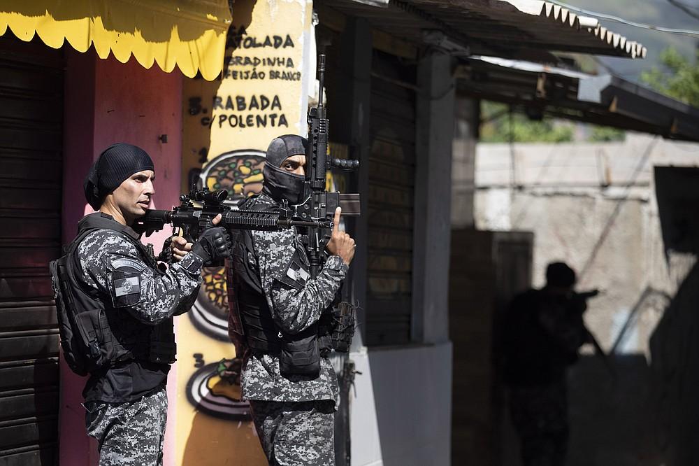 Police conduct an operation against alleged drug traffickers in the Jacarezinho favela of Rio de Janeiro, Brazil, Thursday, May 6, 2021. (AP Photo/Silvia Izquierdo)