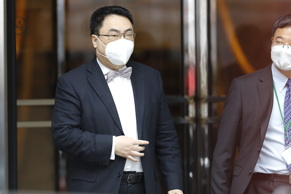 The ambassador of the Permanent Mission of the People's Republic of China to the United Nations, Wang Qun, leaves the 'Grand Hotel Wien' where closed-door nuclear talks with Iran take place in Vienna, Austria, Friday, May 7, 2021. (AP Photo/Lisa Leutner)