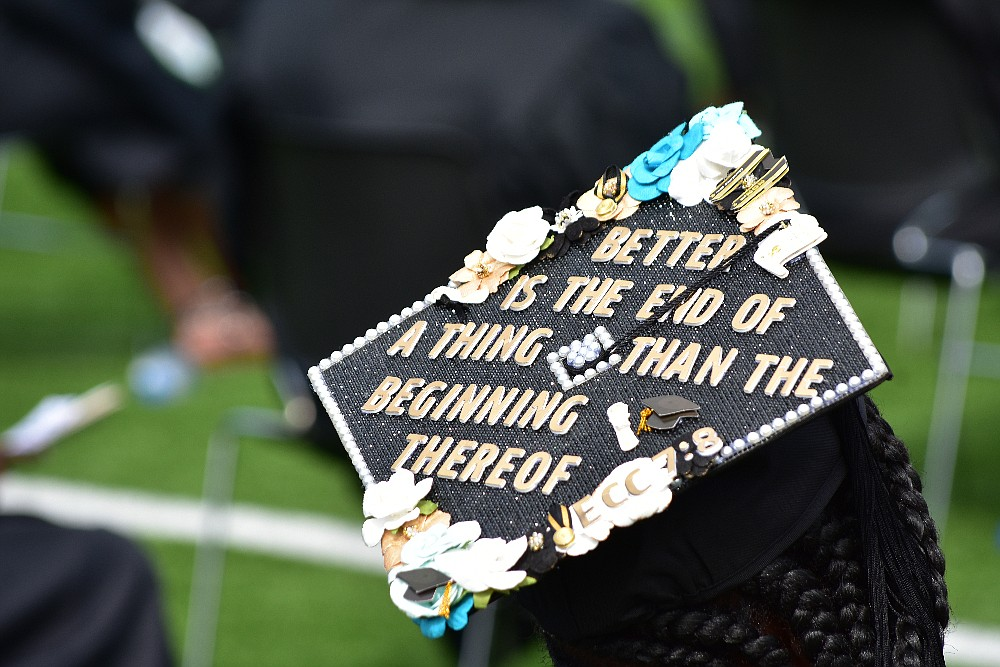 A student wears a designed mortar board with a King James Version scripture of Ecclesiastes 7:8 during UAPB spring commencement Saturday, May 8, 2021, at Simmons Bank Field. (Pine Bluff Commercial/I.C. Murrell)