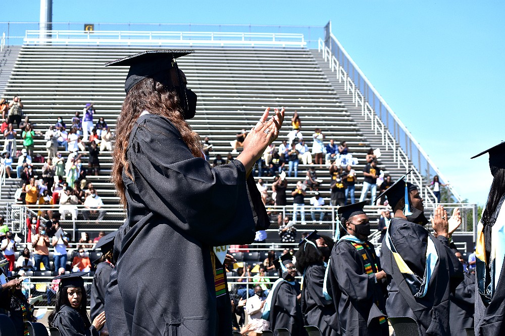 UAPB graduates give bestselling author and political commentator Michael Eric Dyson a standing ovation following his commencement address during sprint commencement Saturday, May 8, 2021, at Simmons Bank Field. (Pine Bluff Commercial/I.C. Murrell)