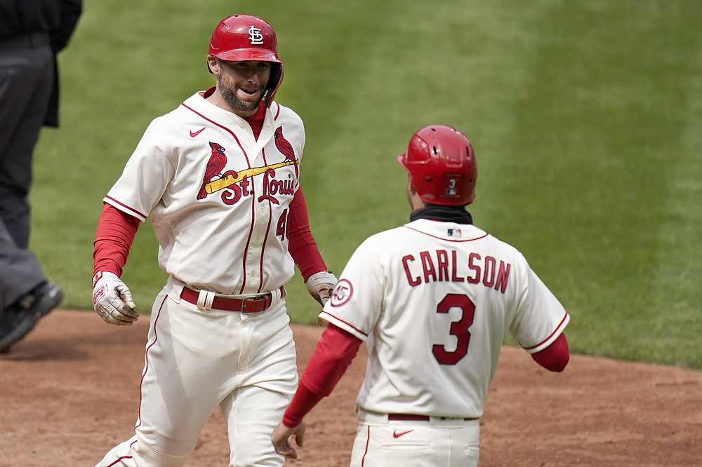 St. Louis Cardinals' Paul Goldschmidt, left, is congratulated by teammate Dylan Carlson (3) after hitting a two-run home run during the fifth inning of a baseball game against the Colorado Rockies Saturday, May 8, 2021, in St. Louis. (AP Photo/Jeff Roberson)