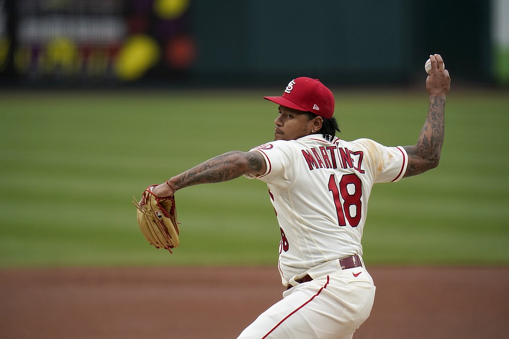 St. Louis Cardinals starting pitcher Carlos Martinez throws during the first inning of a baseball game against the Colorado Rockies Saturday, May 8, 2021, in St. Louis. (AP Photo/Jeff Roberson)