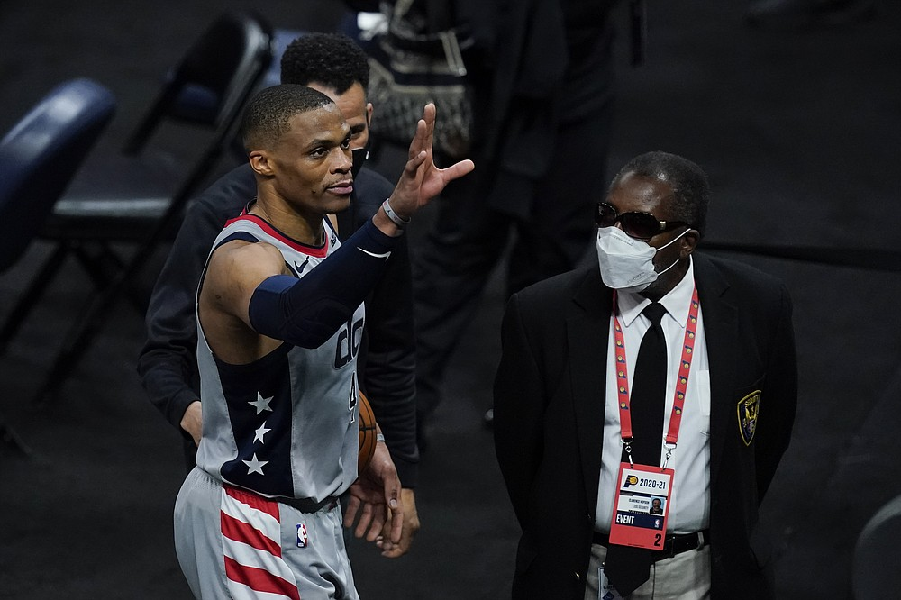 Washington Wizards' Russell Westbrook waves to fans as he leaves the court following an NBA basketball game against the Indiana Pacers, Saturday, May 8, 2021, in Indianapolis. Washington won 133-132 in overtime. (AP Photo/Darron Cummings)