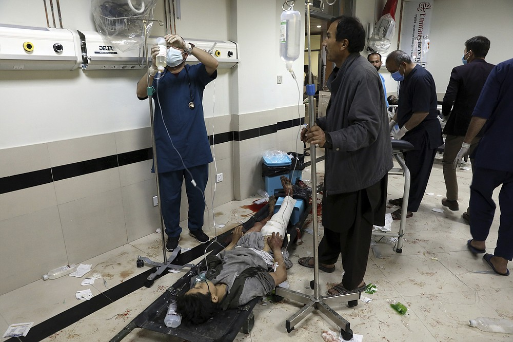 An Afghan school student treated at a hospital after a bomb explosion near a school west of Kabul, Afghanistan, Saturday, May 8, 2021. A bomb exploded near a school in west Kabul on Saturday, killing several people, many them young students, an Afghan government spokesmen said. (AP Photo/Rahmat Gul)