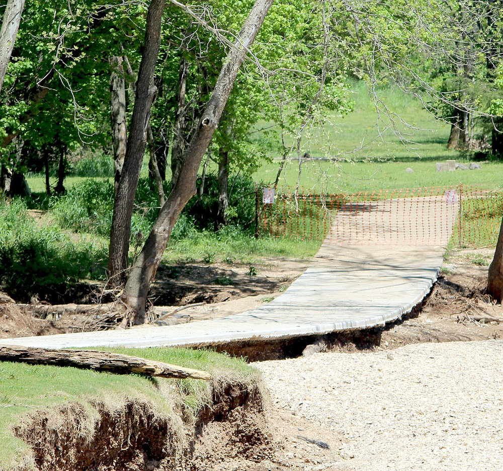 Keith Bryant/The Weekly Vista A portion of the Lake Bella Vista trail, which has been closed for repairs, was undercut by flood waters during the late April rainstorms.