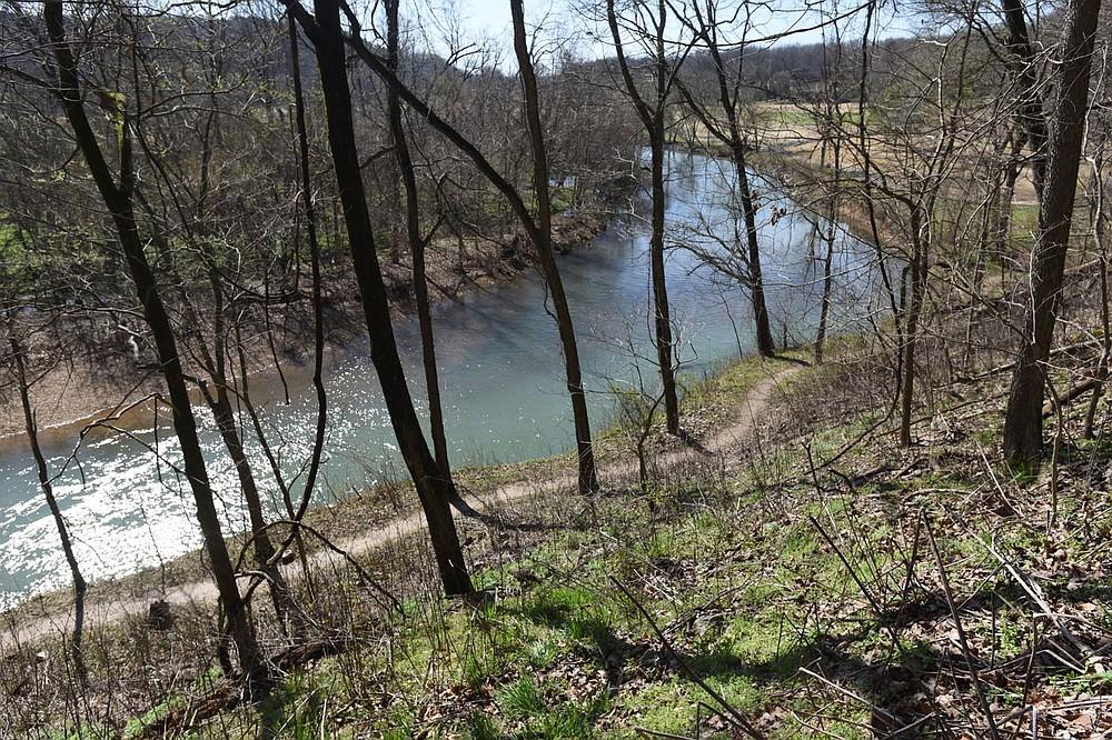 A lower trail can be seen March 26 2021 from a higher trail along Little Sugar Creek. (NWA Democrat-Gazette/Flip Putthoff)