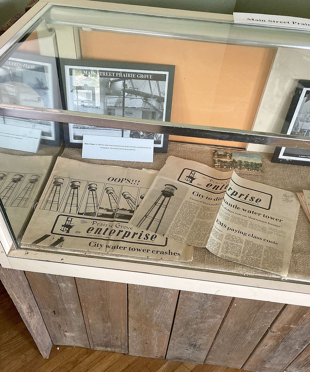 MAYLON RICE SPECIAL TO ENTERPRISE-LEADER Prairie Grove Heritage Museum includes these copies of the former Prairie Grove Enterprise newspaper. This is the issue that was published when the city water tower crashed.