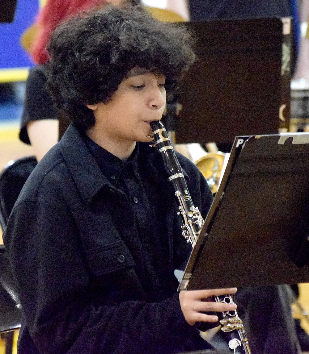 Westside Eagle Observer/MIKE ECKELS Alexis Garcia performs a beautiful clarinet solo during the opening of one of the middle school's pieces which was part of the Bulldog Band Spring Concert at Peterson Gym in Decatur May 11.