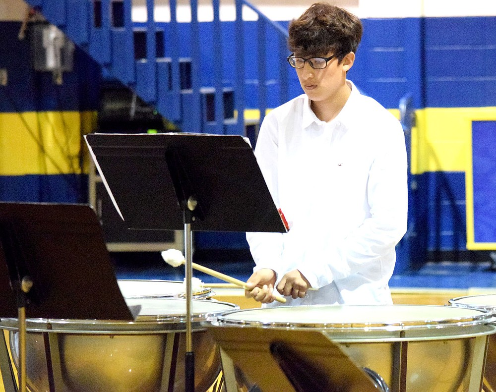 Westside Eagle Observer/MIKE ECKELS Anthony Hernandez uses a cross sticking technique to play his timpani part during the high school band section of the 2021 Bulldog Band Spring Concert at Peterson Gym in Decatur May 11. This technique requires the percussionist to have his wrist up or down while playing instead of the normal side-to-side method of holding the sticks.
