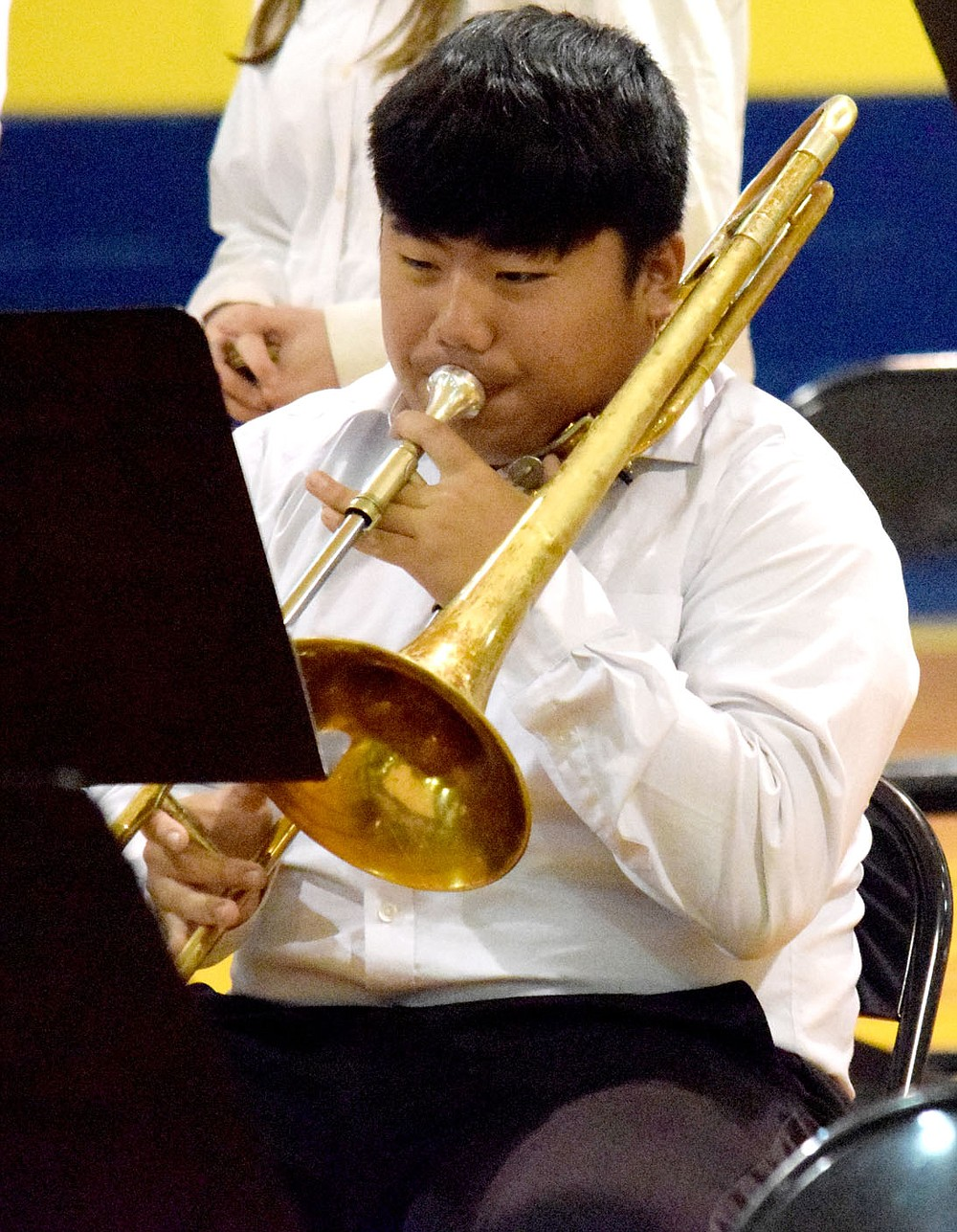 Westside Eagle Observer/MIKE ECKELS Cam'Ron Vang adds his rich trombone tones to one of the high school band pieces during the May 11 Bulldog Band Spring Concert at Peterson Gym in Decatur.