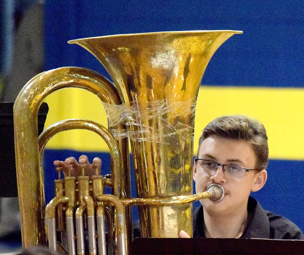 Westside Eagle Observer/MIKE ECKELS Emilio Smith-Gomez watches directions from Jesse Owens (off camera) as he plays his the tuba part during the middle school band portion of the Bulldog Band Spring Concert May 11 at Peterson Gym in Decatur.