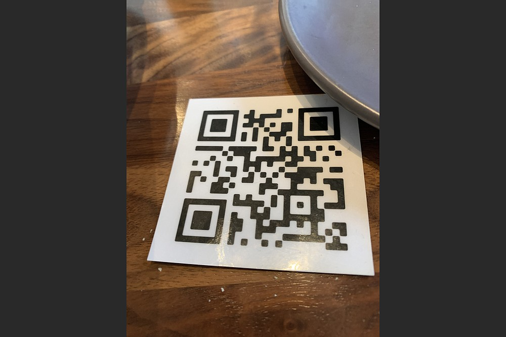 The restaurant prefers customers use a non-contact QR to call the menu up on their cell phones, but paper menus are available for those who can't or won't. (Arkansas Democrat-Gazette/Eric E. Harrison)
