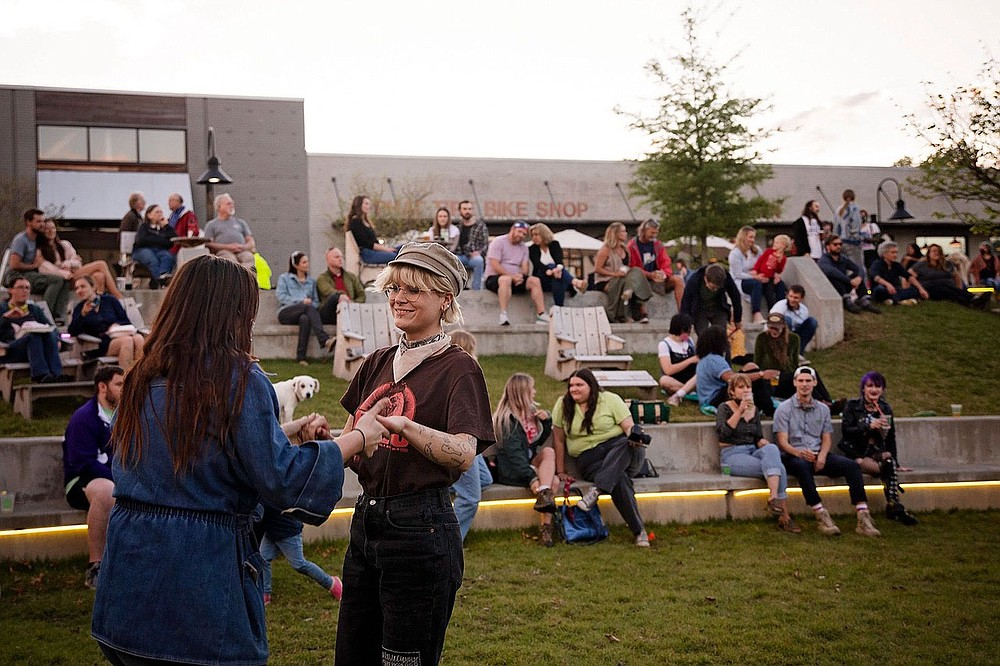 Dancers enjoy a recent Live at Turnbow outdoor concert, part of a music series presented by the Downtown Springdale Alliance in Walter Turnbow Park.  (Courtesy photo)