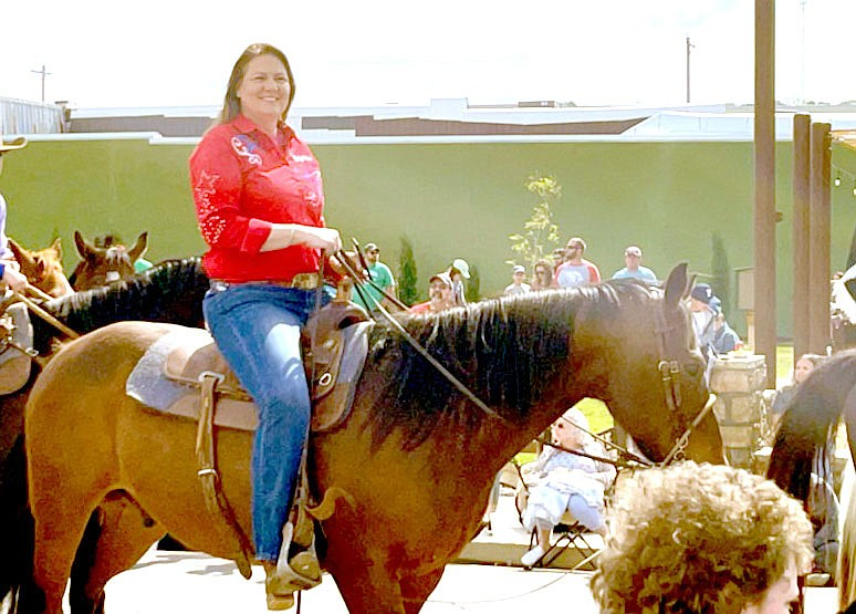 Marc Hayot/Herald-Leader Kaci Reed Johnson rides her horse in the Stilwell Strawberry Festival parade on May 8. Johnson and her father's company Realty Mart were recognized as one of the event's top sponsors. The company donated two guns to the Round Up Club and earned $960 for the club by selling raffle tickets.