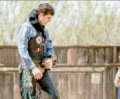 Marc Hayot/Herald-Leader Jayco Roper, a bronc rider from Oktaha, Oklahoma is waiting to compete on May 8 in the Stilwell Strawberry Festival Rodeo. Roper is one of several rodeo contestants sponsored by Kaci Reed Johnson and Realty Mart.