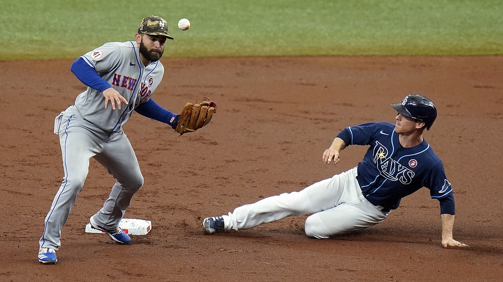 Tampa Bay Rays' Joey Wendle, right, steals second base as the ball gets away from New York Mets second baseman Jose Peraza during the first inning of a baseball game Saturday, May 15, 2021, in St. Petersburg, Fla. (AP Photo/Chris O'Meara)