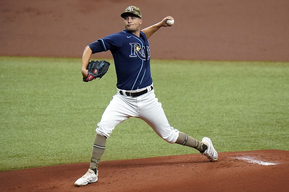 Tampa Bay Rays' Shane McClanahan pitches to the New York Mets during the first inning of a baseball game Saturday, May 15, 2021, in St. Petersburg, Fla. (AP Photo/Chris O'Meara)