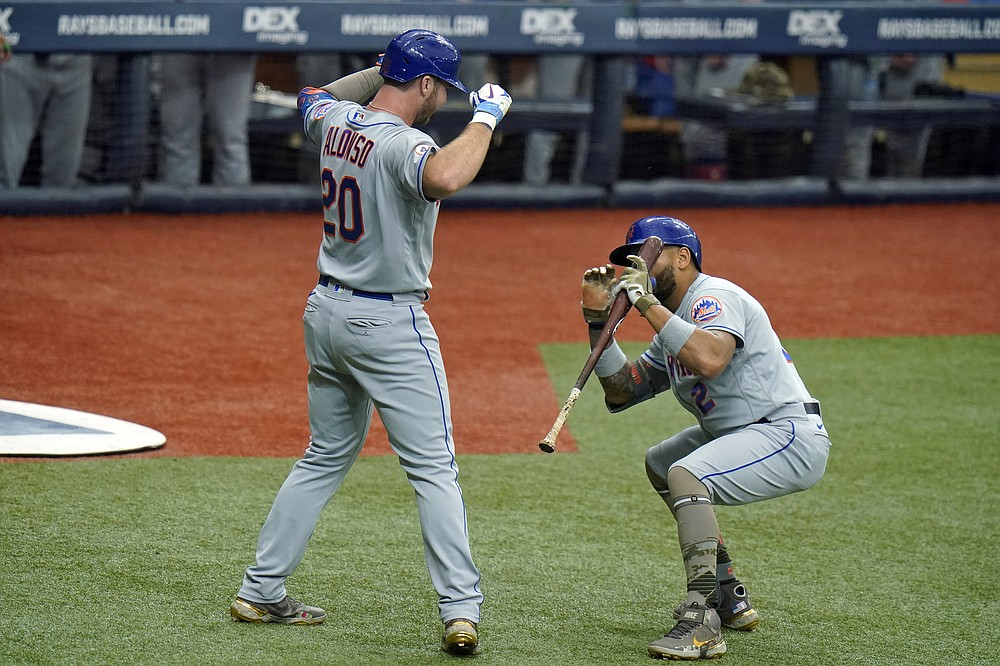 New York Mets' Pete Alonso (20) pretends to pose for a photo for Dominic Smith after Alonso hit a solo home run off Tampa Bay Rays starting pitcher Shane McClanahan during the third inning of a baseball game Saturday, May 15, 2021, in St. Petersburg, Fla. (AP Photo/Chris O'Meara)