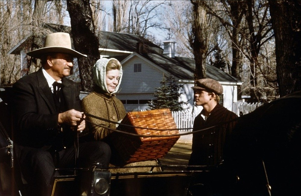 """Lauren Bacall and a young Ron Howard star with """"The Duke"""" (John Wayne) in """"The Shootist"""" (1976)."""