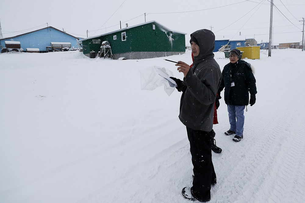 FILE - In this Jan. 20, 2020, file photo, census workers verify that their maps match up to the right amount of houses in Toksook Bay, Alaska, a mostly Yup'ik village on the edge of the Bering Sea. Alaska's population grew by 23,160 people, or 3.3%, in the last decade, according to the first numbers released Monday for the 2020 Census. (AP Photo/Gregory Bull, File)
