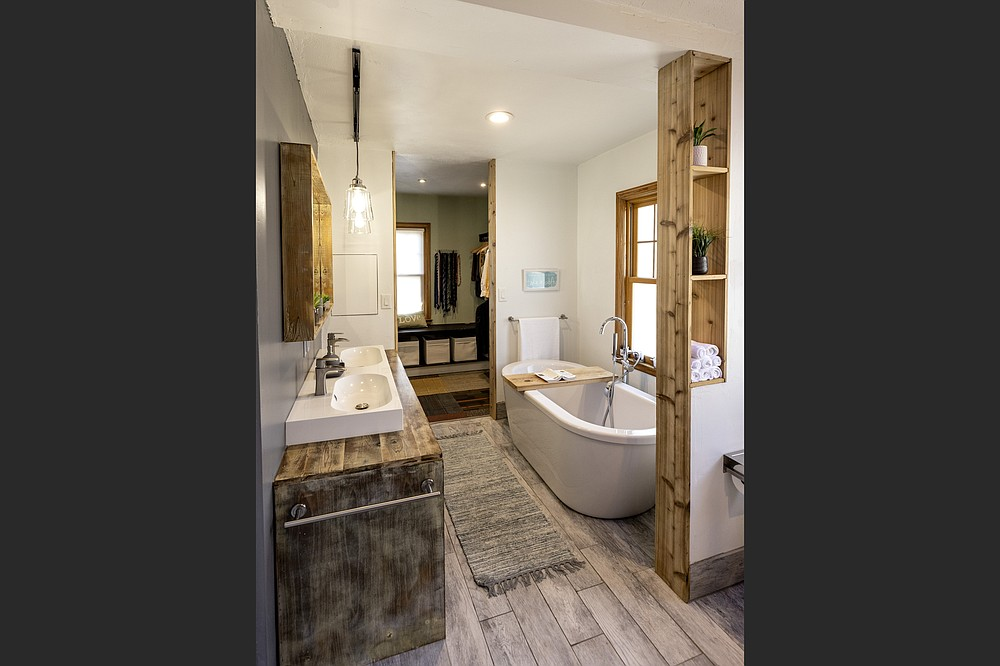 This image shows the remodeled bathroom and closet at the home of Wale Falade and Funmi Okanla-Falade in St. Paul, Minn. (TNS/Minneapolis Star Tribune/Carlos Gonzalez)