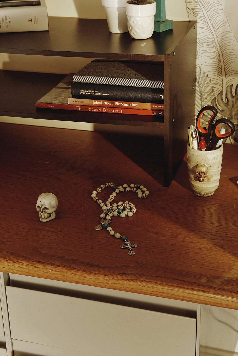 """Items that Sister Theresa Aletheia Noble has collected that incorporate skull imagery, at Daughters of St. Paul convent in Boston, May 12, 2021. Since 2017, Sister Aletheia has made it her mission to revive the practice of memento mori, a Latin phrase meaning """"Remember your death,"""" which encourages intentional thought about one's death every day as a means of appreciating the present and focusing on the future. (Tony Luong/The New York Times)"""