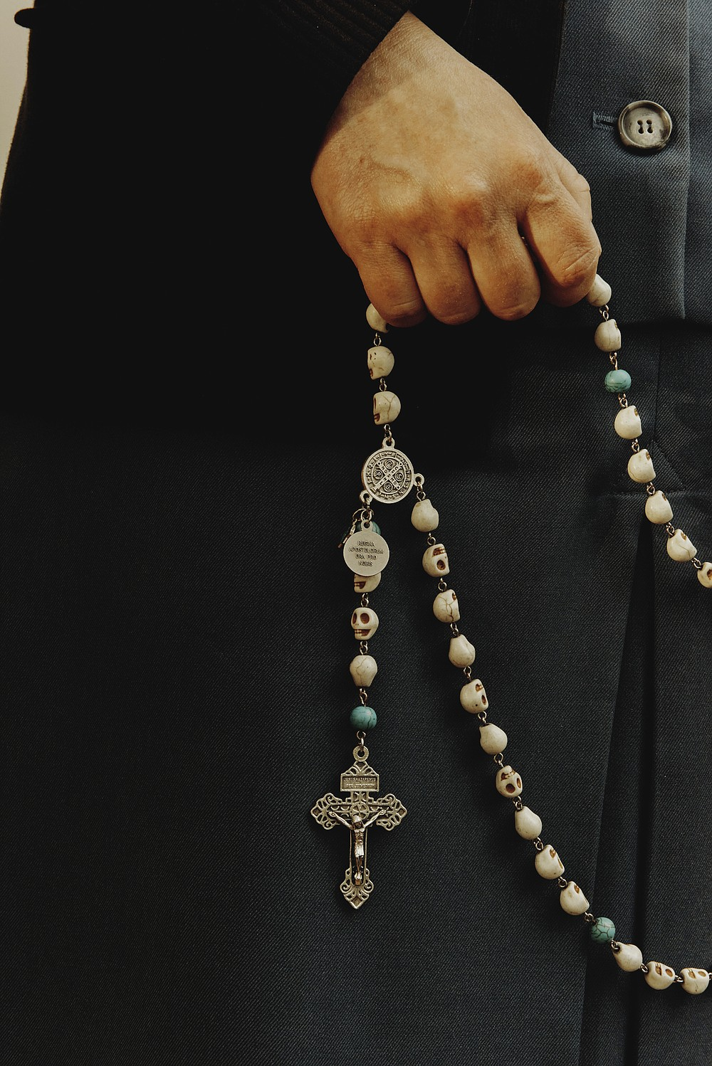 """Sister Theresa Aletheia Noble holds a rosary with skull beads at Daughters of St. Paul convent in Boston. Since 2017, Sister Aletheia has made it her mission to revive the practice of memento mori, a Latin phrase meaning """"Remember your death,"""" which encourages intentional thought about one's death every day as a means of appreciating the present and focusing on the future. (The New York Times/Tony Luong)"""
