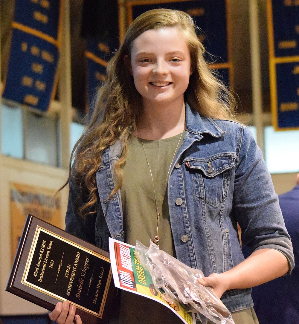 Westside Eagle Observer/MIKE ECKELS Senior Anabelle Schopper displays several awards she received during the 2021 Bulldogs Sports Award program at Peterson Gym in Decatur May 18. Schopper was named 2021 Lady Bulldogs Basketball Most Valuable Player as well as Tyson Achievement and KURM 2021 Basketball Dream Team awards.