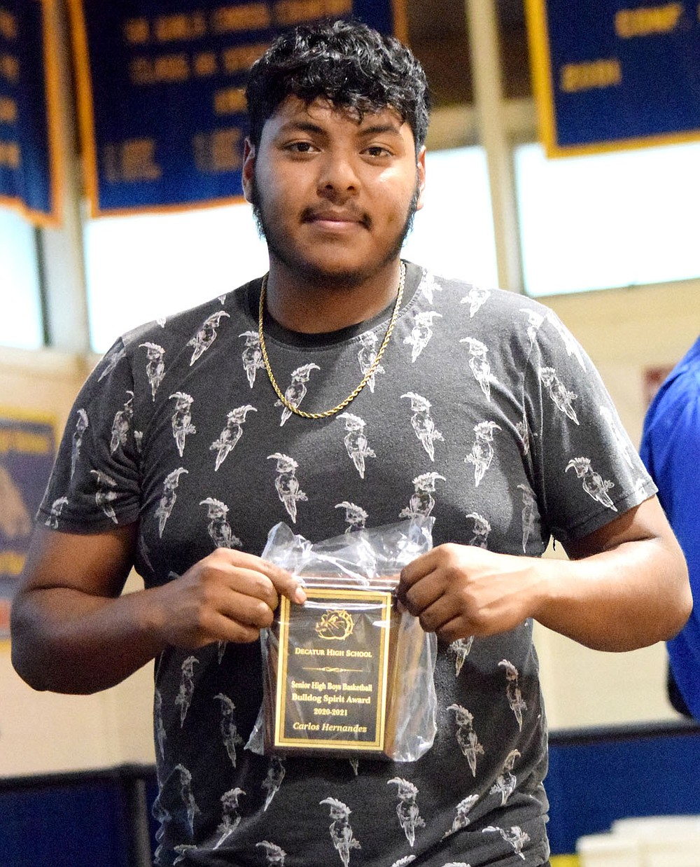 Westside Eagle Observer/MIKE ECKELS  Carlos Hernandez displays his Bulldog Spirit Award in basketball during the 2021 Bulldog Sports Award Program in Decatur May 18. Hernandez was the backbone for the 2021 Decatur Bulldog soccer team leading the offensive drives with 17 goals this season. His efforts earned him a sport on the 3A State Soccer team as well as the Bulldogs Most Valuable Player of the Year award he also received during the sports program.