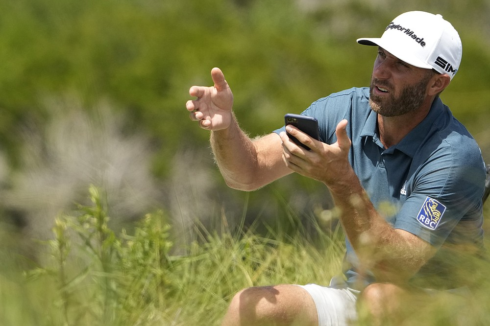 Dustin Johnson waits to tee off on the 11th hole during a practice round at the PGA Championship golf tournament on the Ocean Course Wednesday, May 19, 2021, in Kiawah Island, S.C. (AP Photo/David J. Phillip)